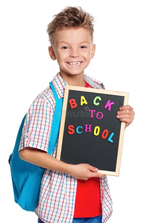 有小黑板的男孩-回到学校 免版税库存照片