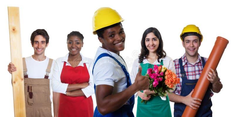 有小组的笑的非裔美国人的建筑工人其他工作者 库存照片