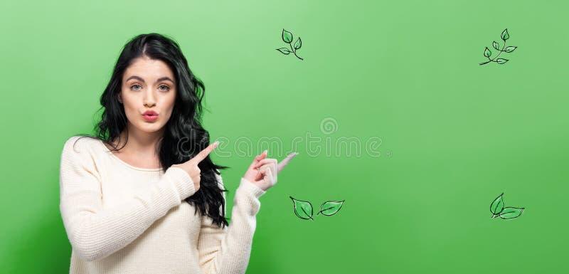 有少妇的绿色叶子 免版税库存图片