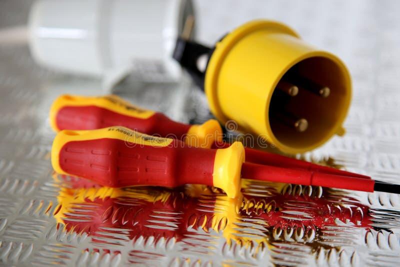 有工业电火花塞的电子螺丝刀 图库摄影
