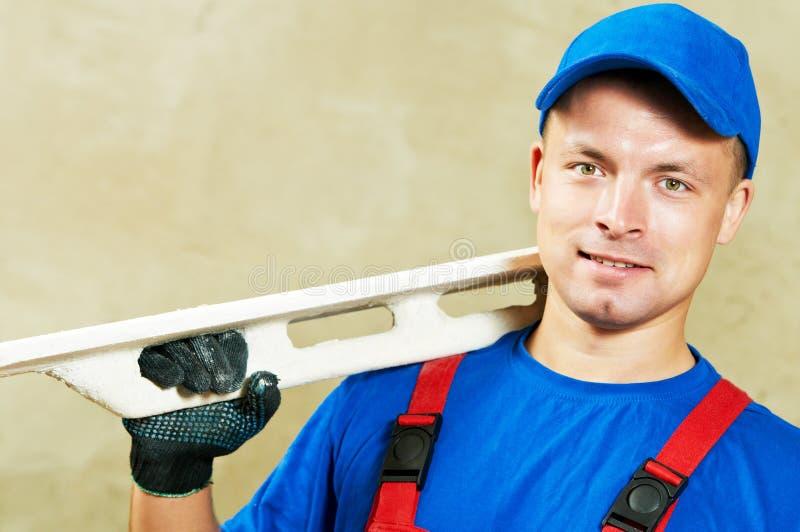 有工作工具的石膏工 免版税库存照片