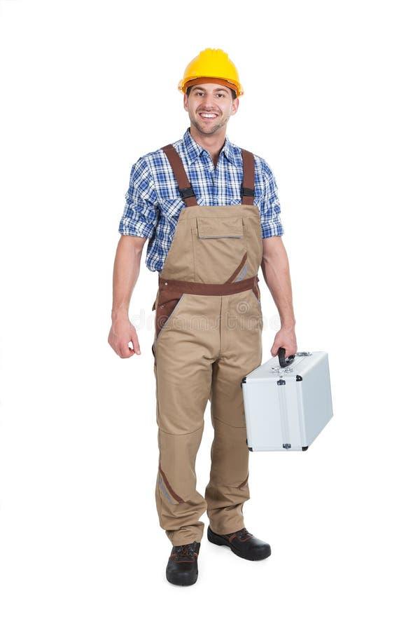 有工具箱的体力工人 库存照片