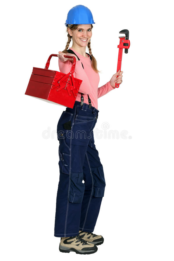 有工具箱的女性工作者 免版税库存照片