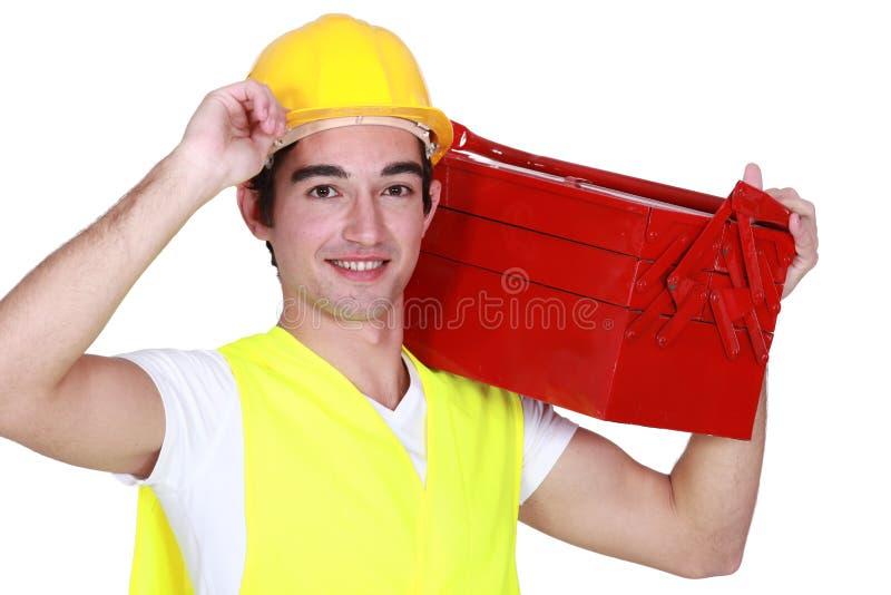 有工具箱的年轻人 库存照片