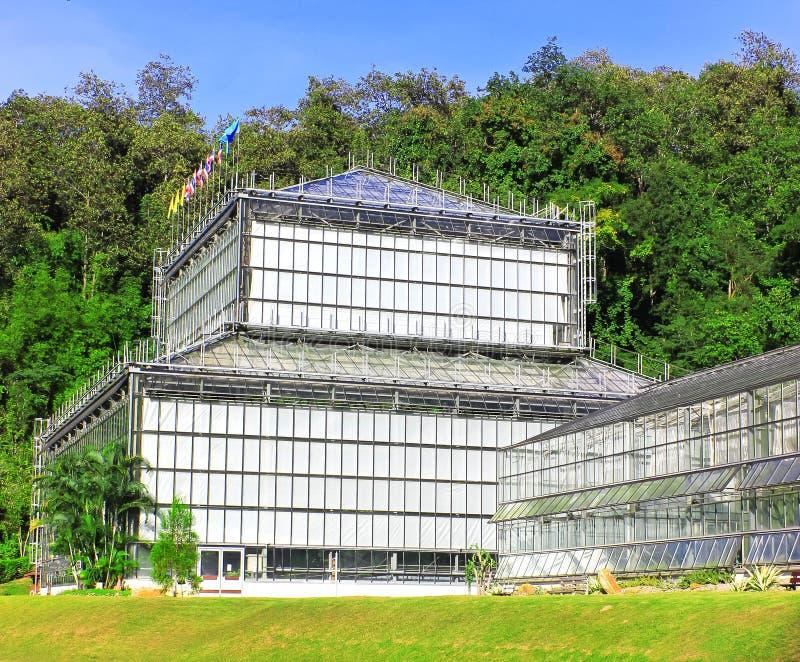 有工厂的玻璃温室 图库摄影