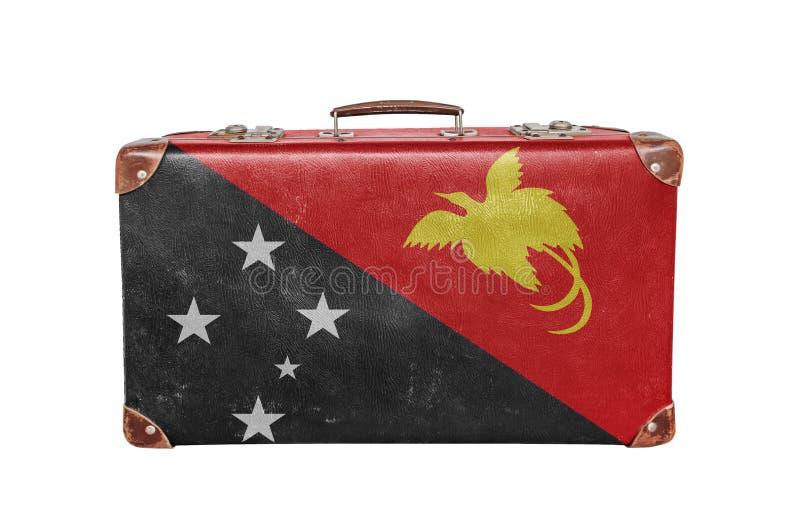 有巴布亚新几内亚旗子的葡萄酒手提箱 库存图片