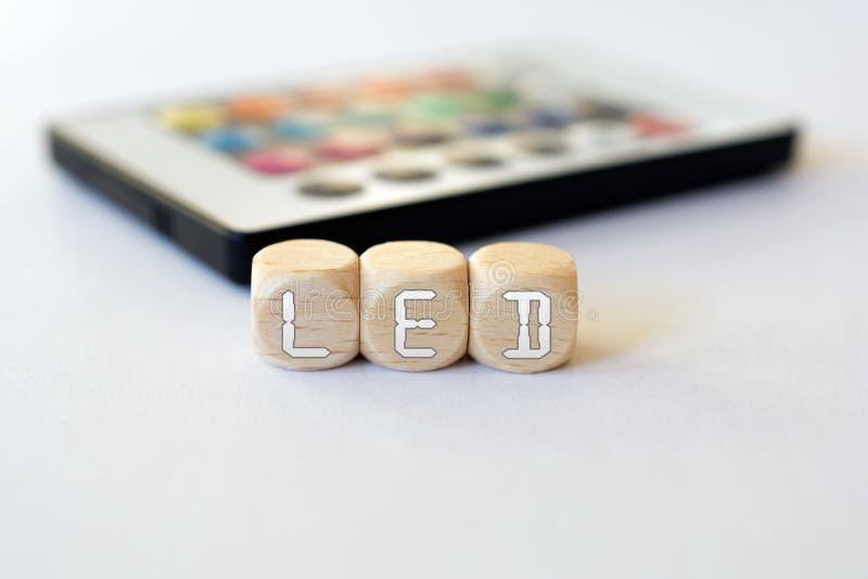 有带领立方体首字母缩略词的LED遥控 免版税图库摄影