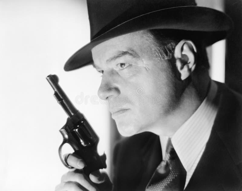 有帽子的一个人和枪(所有人被描述不更长生存,并且庄园不存在 供应商保单将有 免版税图库摄影