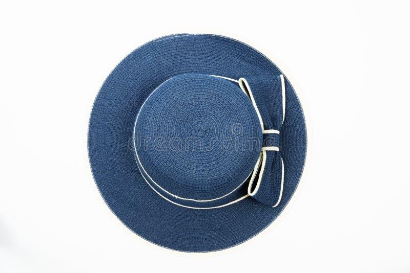 有弓的妇女蓝色帽子在白色背景 库存图片