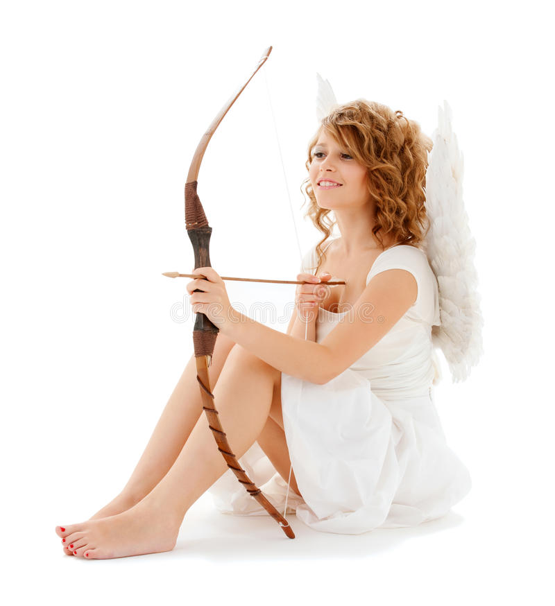 有弓箭的愉快的少年cupidl女孩 免版税库存照片