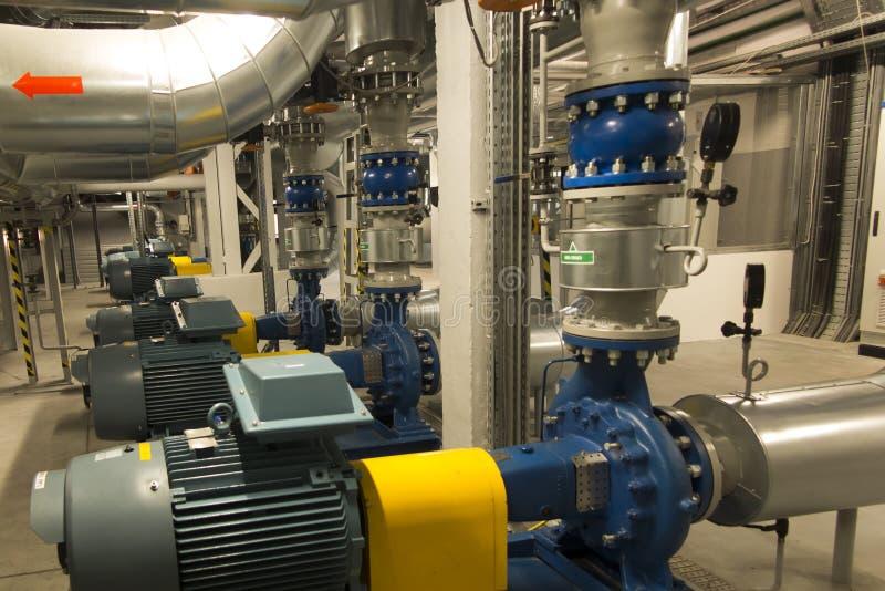 有引擎的几个泵浦在供水系统 免版税库存图片