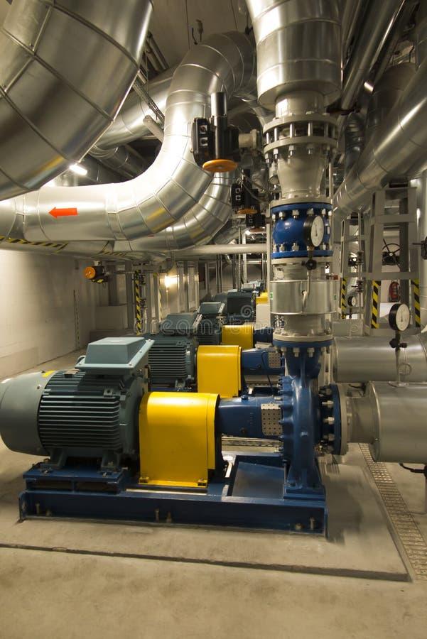 有引擎的几个泵浦在供水系统 免版税库存照片