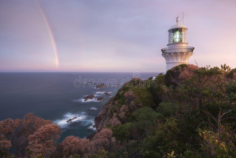 有彩虹的灯塔 库存图片