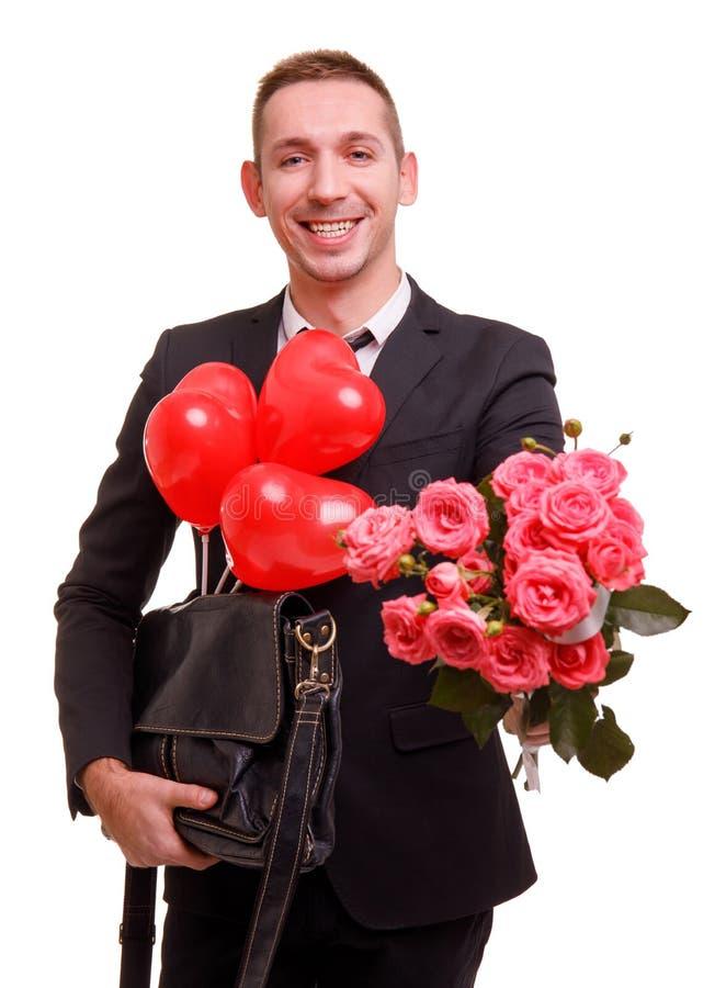 有微笑的一个人舒展了花束今后在白色被隔绝的背景 免版税库存照片