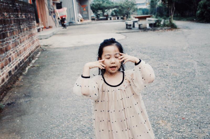 有微笑面孔的亚裔女孩 库存图片