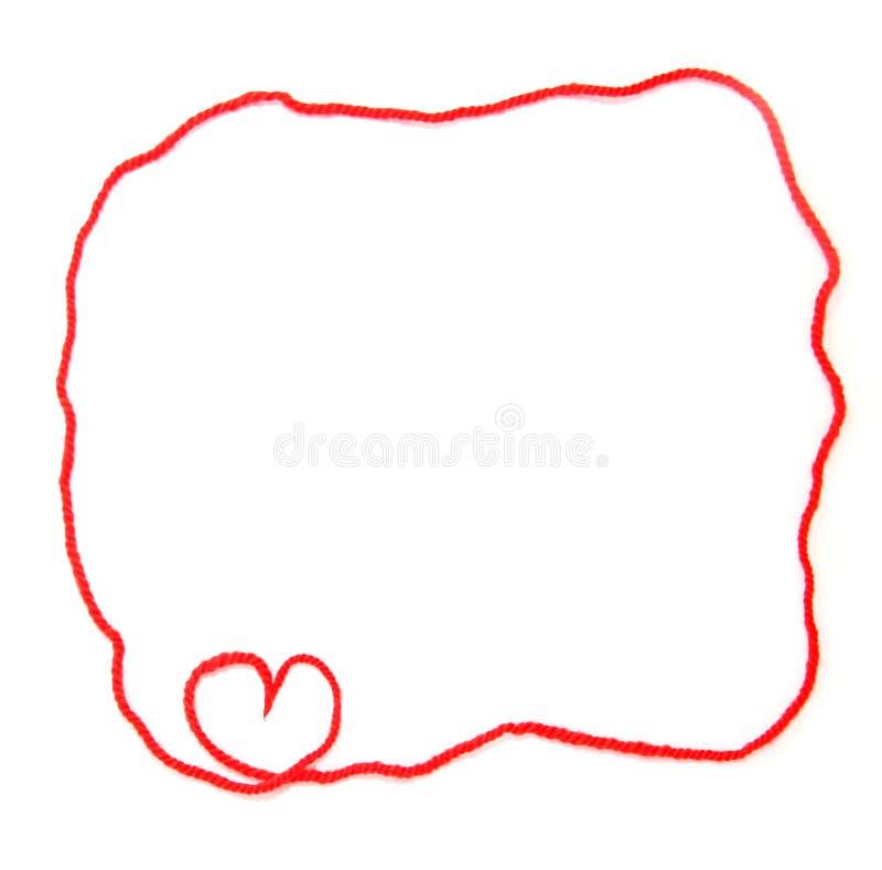 有心脏的红色丝球钩针编织的 库存图片