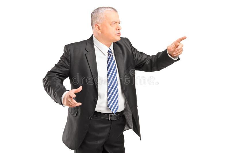 有恼怒的上司争论和指向与手指 免版税图库摄影