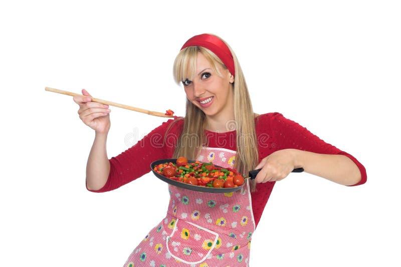 有愉快的主妇乐趣烹调 库存照片