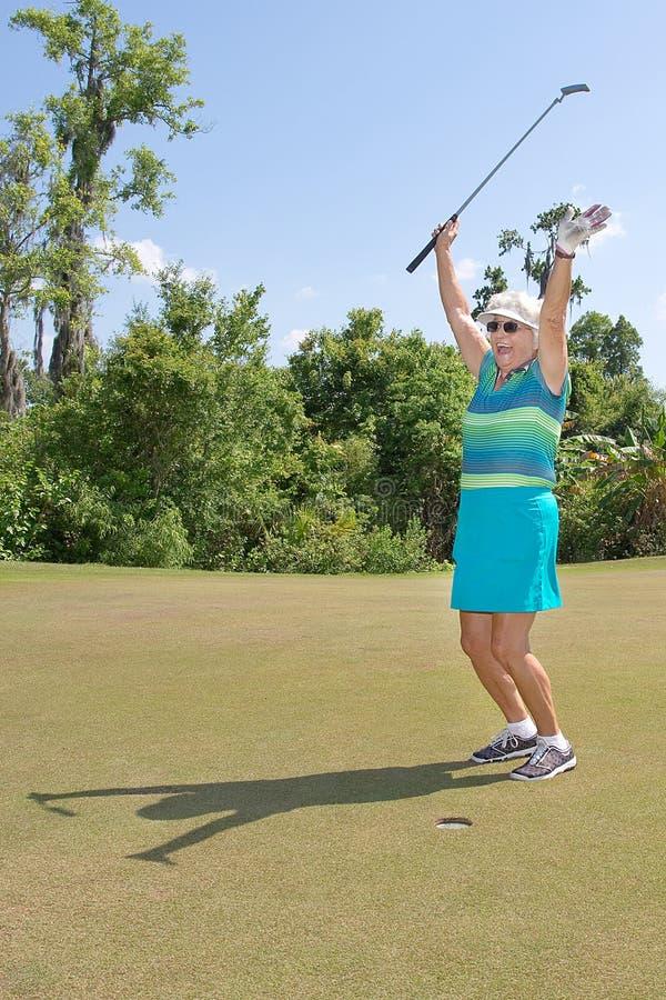 有愉快的表示的资深高尔夫球运动员 免版税图库摄影