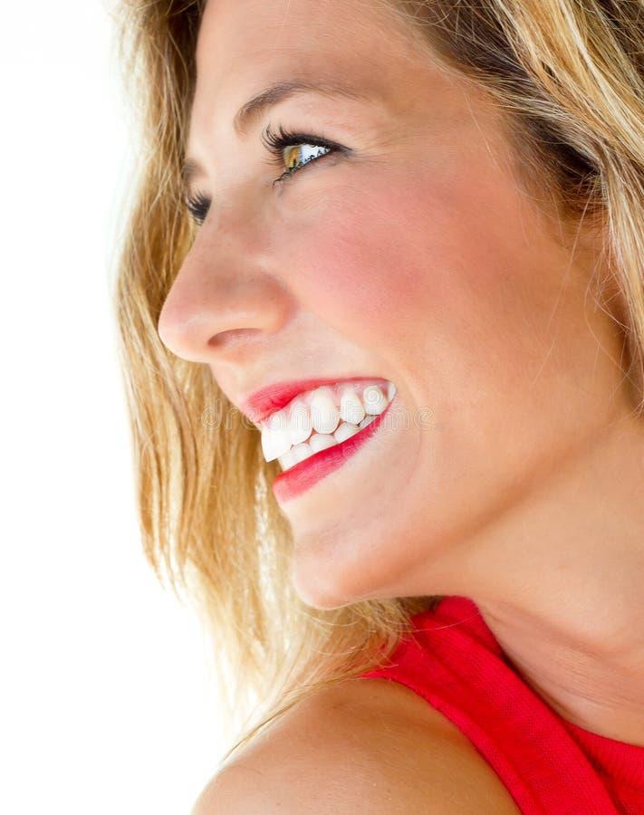 有意想不到的微笑的妇女 库存图片
