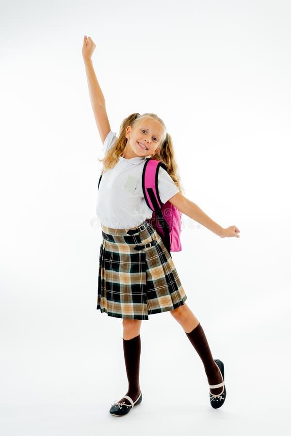 有感觉激动和愉快是回到学校的大桃红色书包的可爱的美丽的矮小的女小学生隔绝在白色 免版税图库摄影