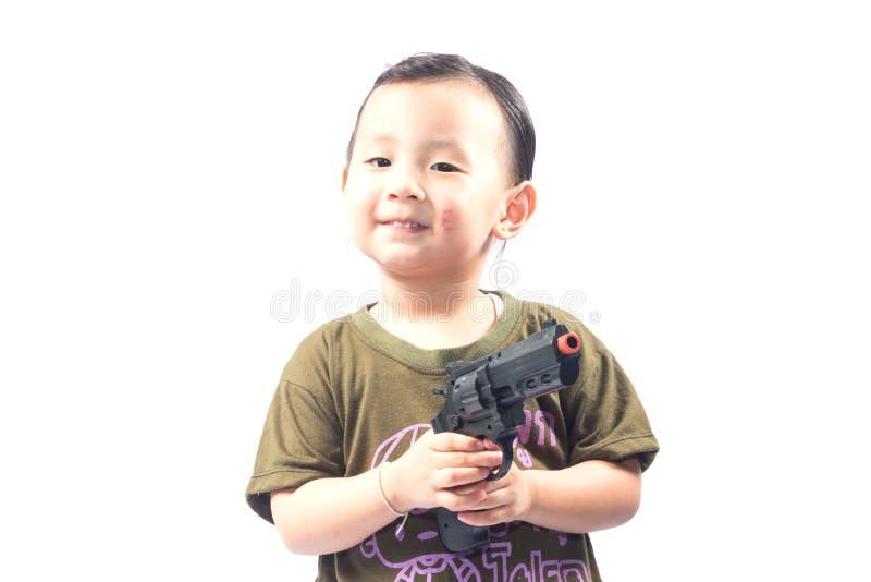 有战士衣服的小女孩 免版税图库摄影