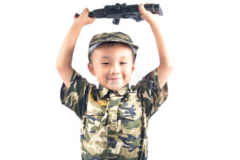 有战士衣服的小男孩 免版税图库摄影