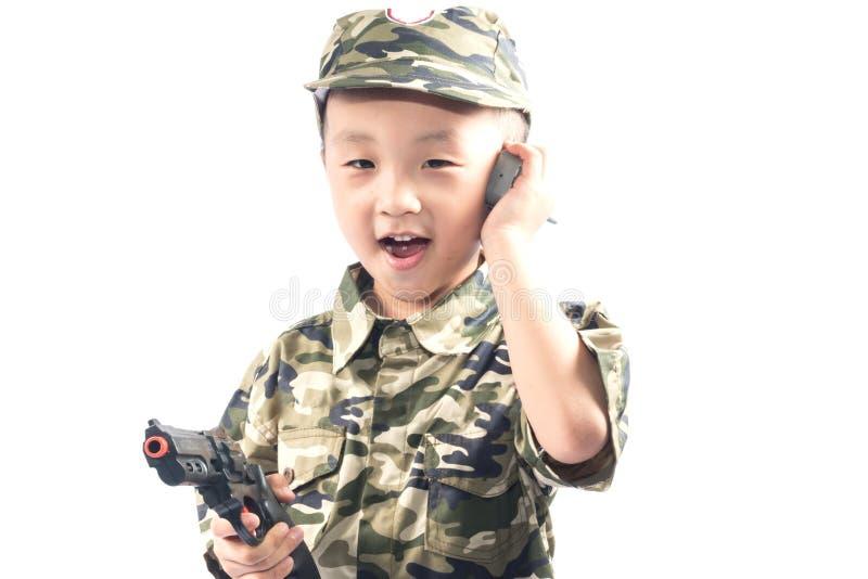 有战士衣服的小男孩 免版税库存图片