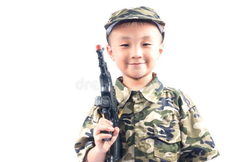 有战士衣服的小男孩 免版税库存照片