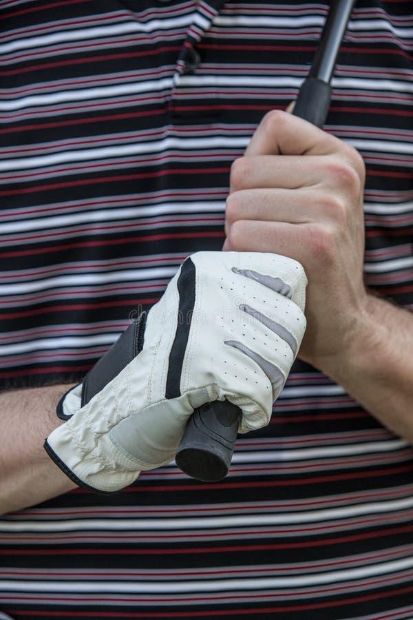 有手套藏品俱乐部的高尔夫球运动员 免版税库存图片