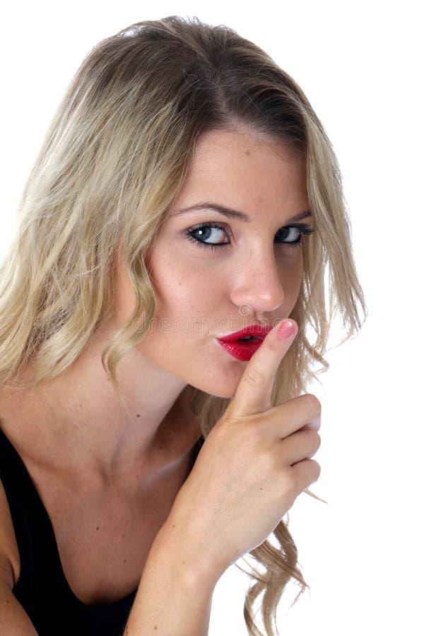 有手指的秘密的害怕少妇对嘴唇 图库摄影