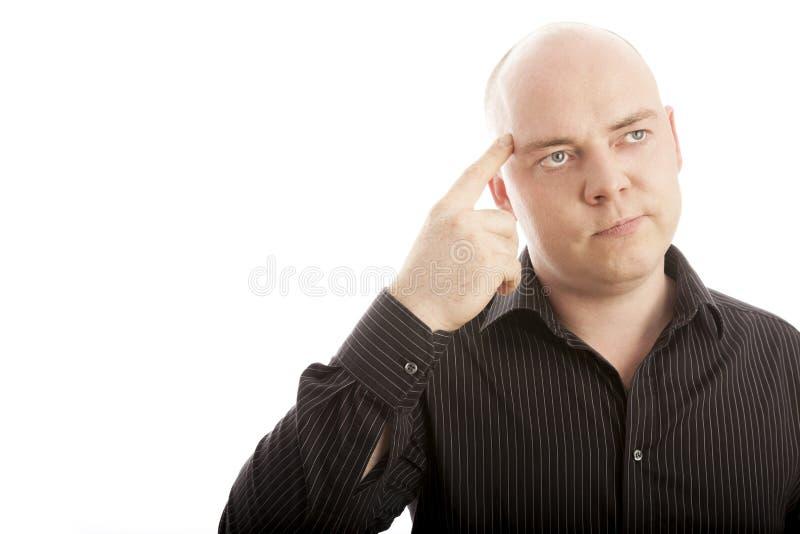 有手指认为的秃头人 免版税库存图片