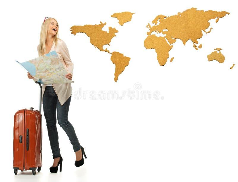 有手提箱和地图的妇女 库存照片