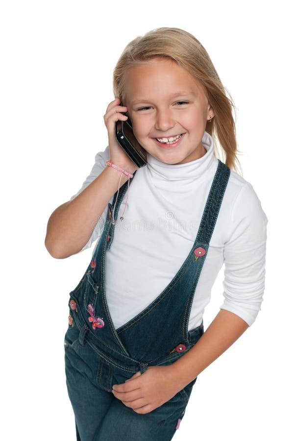 有手机的微笑的女孩 免版税库存照片