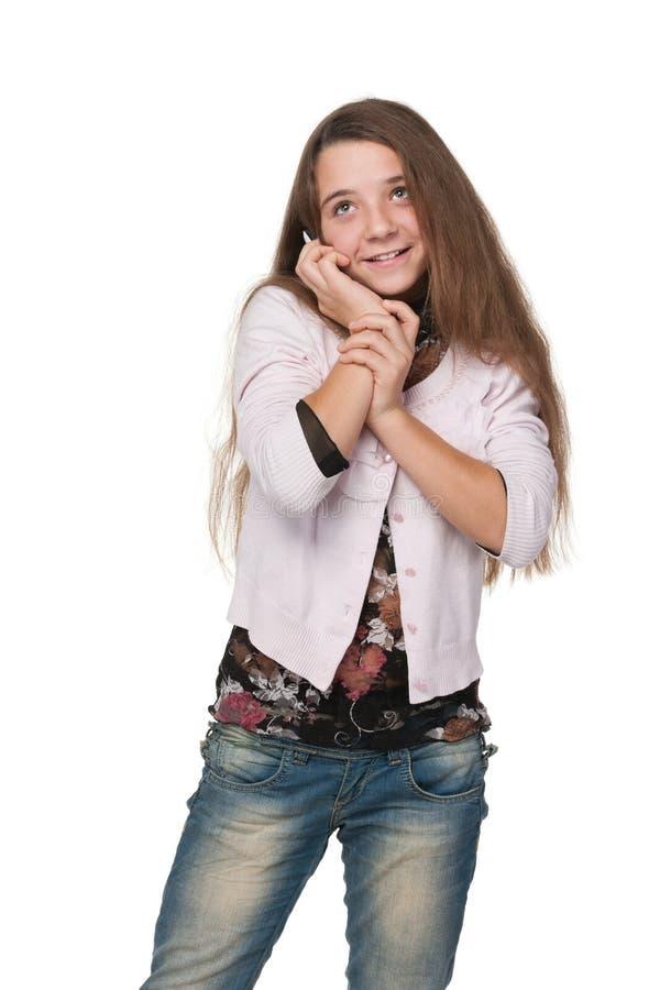 有手机的微笑的青少年的女孩 库存图片