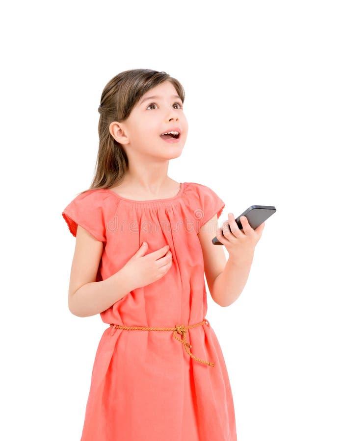 有手机的被启发的女孩 库存图片