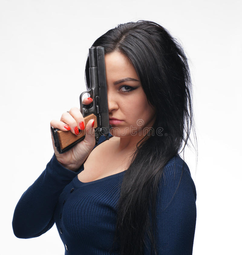 有手枪的女孩 图库摄影