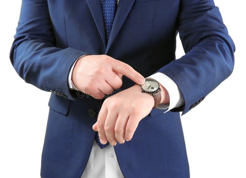 有手表的人反对在白色背景 E 免版税库存照片