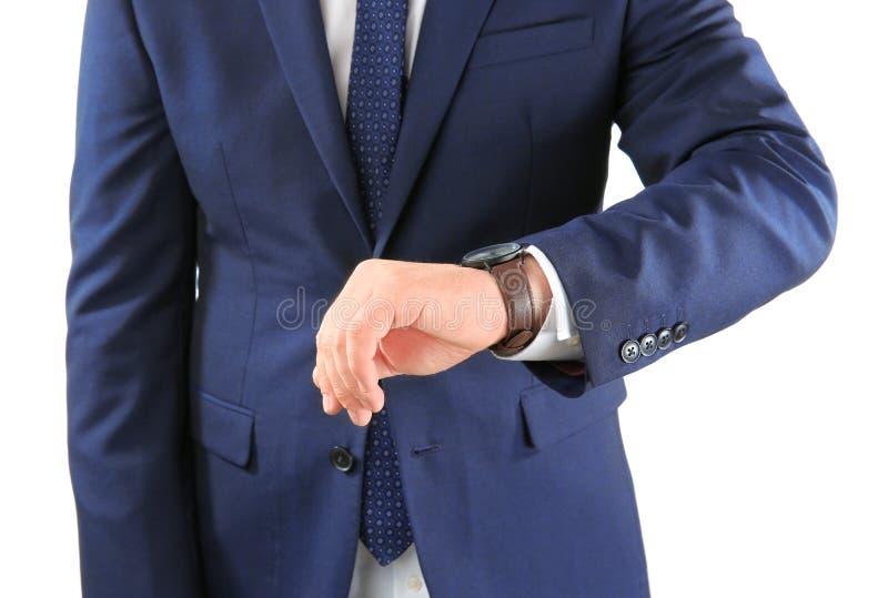 有手表的人反对在白色背景 E 免版税库存图片