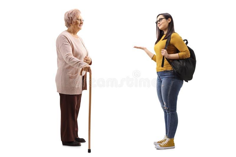 有打手势用手的藤茎和女生的资深妇女 免版税库存图片