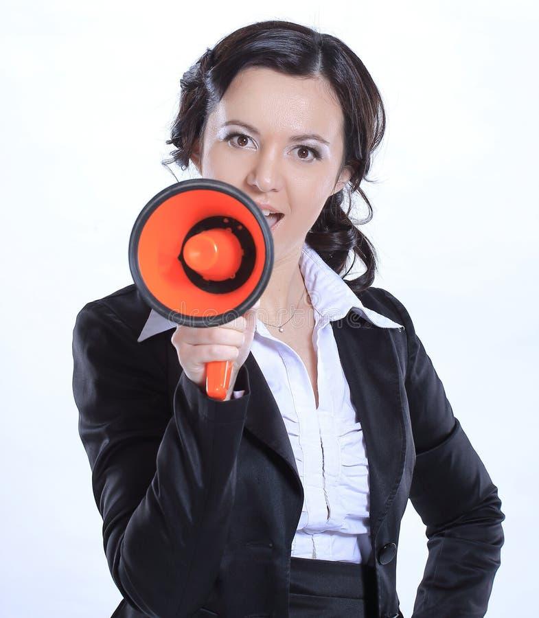 有扩音机的成功的女商人 背景查出的白色 库存图片