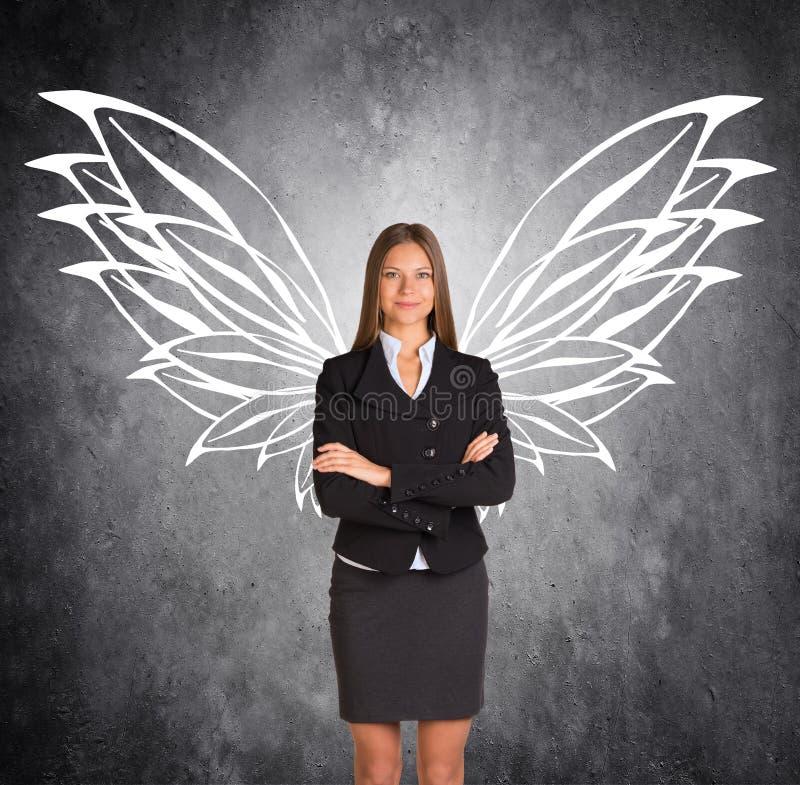 有拉长的蝴蝶翼的女实业家 免版税库存图片