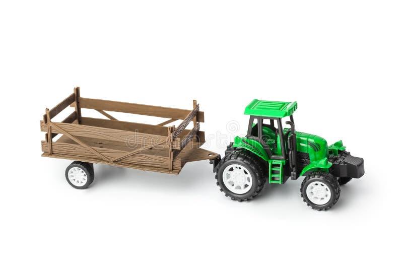 有拖车的玩具拖拉机 免版税图库摄影