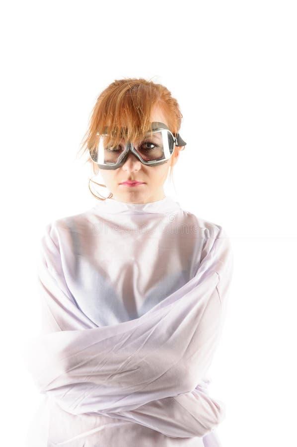 有拘身衣的年轻疯狂的妇女有试验玻璃的 库存图片
