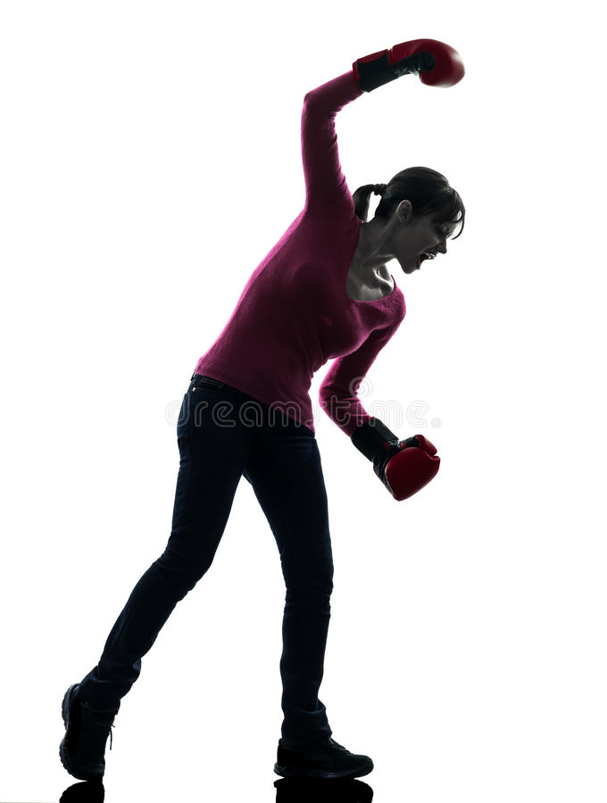 有拳击手套剪影的成熟妇女 免版税图库摄影