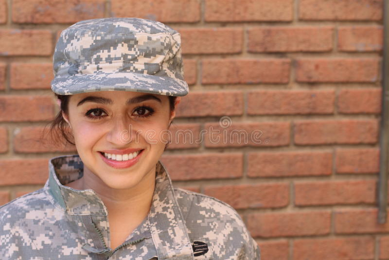 有拷贝空间的军事西班牙军队妇女在右边 库存照片