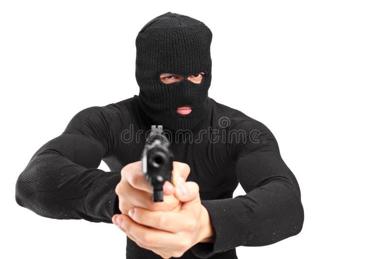 有拿着枪的面具的人 免版税库存图片
