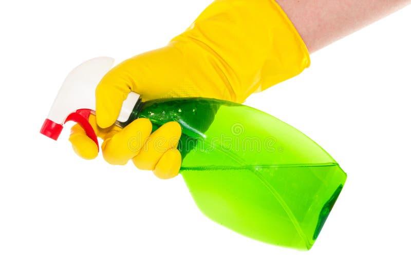 有拿着浪花瓶的家庭手套的手 免版税图库摄影