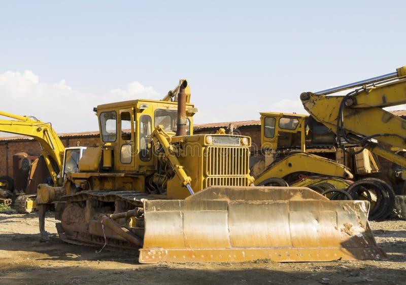 有挖掘机的推土机 免版税库存照片