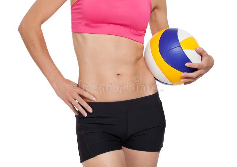 有排球球的运动女孩 库存图片